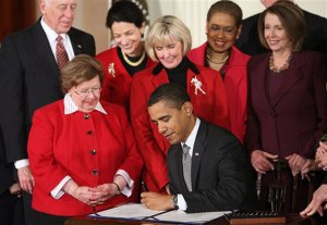 Obama signs the Lilly Ledbetter Act
